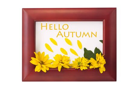 Hello autumn card. Wooden photo frame with yellow flowers on a white background. Home interior decor, mockup, space for text. Beautiful nature, vintage colors, minimal style concept. Stock Photo - 130129191