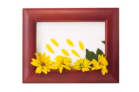 Wooden photo frame with yellow flowers on a white background. Hello autumn card. Home interior decor, mockup, space for text. Beautiful nature, vintage colors, minimal style concept. Stock Photo