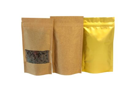 Brown kraft paper and golden metallized foil pouch bags front view isolated on a white background. Packaging for foods and goods, mock-up. Packs with clasps and windows for tea, coffee beans.