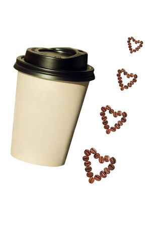 Paper cup with heartshaped coffee beans isolated on a white background. Coffee to go, take away drinks concept, mockup for your brand name.
