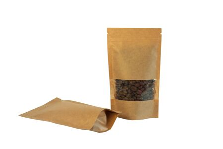 Brown kraft paper pouch bags with coffee beans front view on a white background isolated. Packaging for foods and goods template mockup. Packs with clasps and windows for tea leaves, weight products.