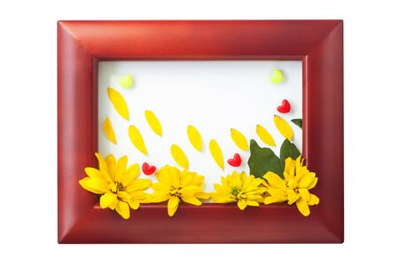 Wooden photo frame with colorful hearts and beautiful yellow flowers with petals like rain drops on a white background isolated. I love you card. Home interior decor, mockup, copy space.Bright colors.