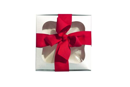 Silver gift box with red ribbon bow isolated on white background. Modern trendy metallic present packaging with window. Contrasting colors, mockup for your brand name. Copy space, flatlay, top view.