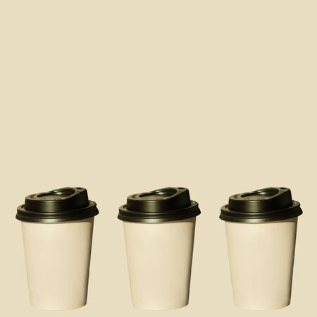 Coffee for free sale, three cups, gift banner. Hot drinks to go isolated on biege pastel background. Take away,fast food. Space for price tag, text, sign.Copy space, brand name mockup, social media Stok Fotoğraf