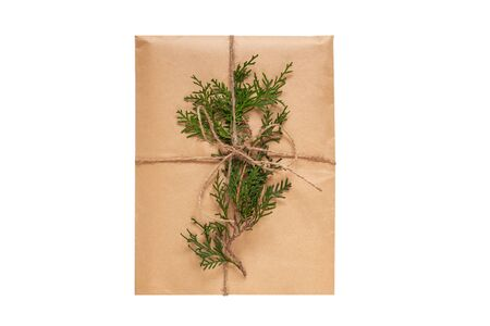 Eco gift box wrapping in kraft paper on white background isolated.Composition present decorated Christmas tree branches. Stok Fotoğraf