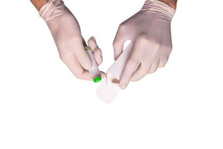 Male doctors hands in rubber gloves holding an ampule of insulin on white backgound isolated. Concept sterility purity, medical clinic, laboratory, glove on the hand of a nurse. Diabetes treatment.