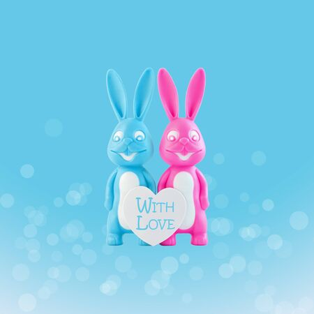 Valentine's day card, cute bunnies happy lovers couple with white heart on blue bokeh background. Family love and dating concept.Easter banner. Pink and blue rabbits.Creative minimal style,copy space Banque d'images