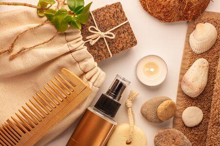 Spa and wellness concept, natural coffee scrub soap, oil cosmetics spray, peeling sand stone,towel,natural wood haircomb