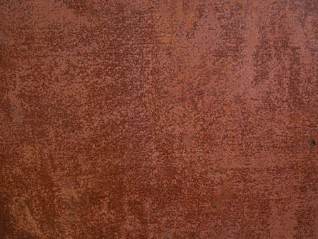 Rusty metal background. Red corroded texture. Damaged surface for text design. Old orange rust backdrop. Architecture exterior detail. Фото со стока
