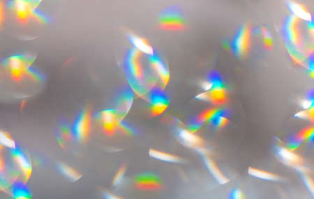 Trendy rainbow neon colors festive sparkling defocused lights. White, yellow and blue bokeh 4K. Perfect stylish abstract overlay footage. Christmas New Year blinking flashing colorful background.