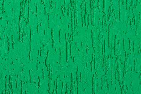 Green painted plaster wall background. Turquoise exterior finish surface. Creative wallpaper, website backdrop for design and text sign. Aqua color decorative texture.