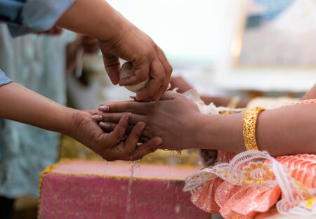 Pour water into the hand. Thai wedding ceremony is to tell the general public that they will live together. Promise to live together with men and women. Creating a shared future for two people.