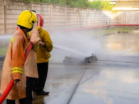 Firefighters are practicing fire fighting prevent emergencies. Use large water hose to put out the fire. The fire caused enormous losses. Must do training prevent fires that may occur in the future.