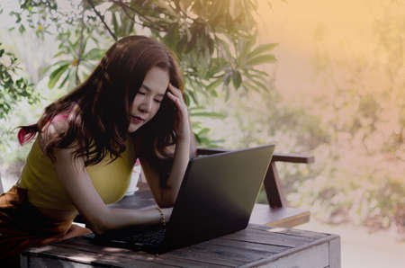 Women working at home with stress. Work on the computer online. The result of the work was not successful. And does not reach the target balance.
