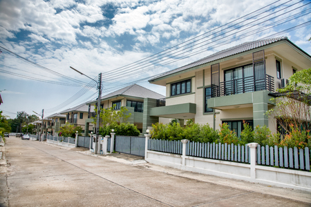 Two storey house with fence