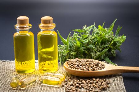 Glass bottles containing CBD hemp oil and drugs extracted from hemp oil of researchers or medical team. Black background. CBD Cannabis Oil, Cannabis Products, Recreation Reklamní fotografie