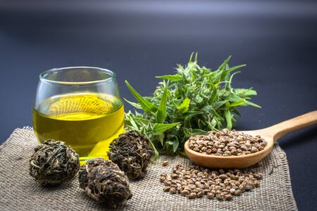 Hemp leaves are placed on seeds and CBD oil bottles. Blackbackground The concept of medical marijuana in the treatment of diseases has.The cycle of marijuana used is refined CBD hemp oil.