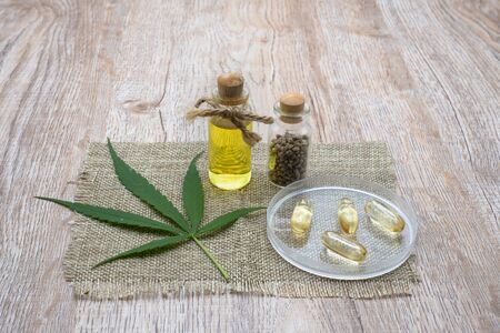 Glass bottles that contain CBD hemp oil and medicine extracted from hemp oil on the table CBD hemp oil concept of alternative medicine Herbs and medicines.