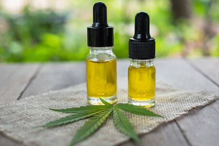 Glass bottles containing hemp oil, CBD and medicine extracted from hemp oil. Concept Medical options CBD hemp oil products Therapy with herbs that are extracted from cannabis.