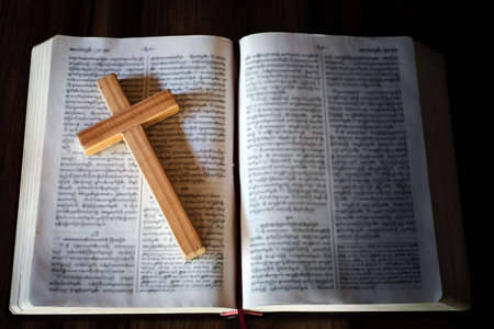 The cross is placed on the scriptures. The concept of praying from the Lord with the power and power of holiness that brings luck and expresses forgiveness through the power of religion, faith.