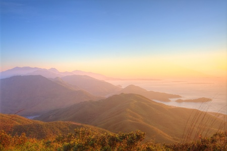 Majestic mountain landscape at sunset in Hong Kong Imagens