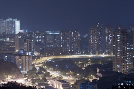 Hong Kong apartment and downtown at night photo