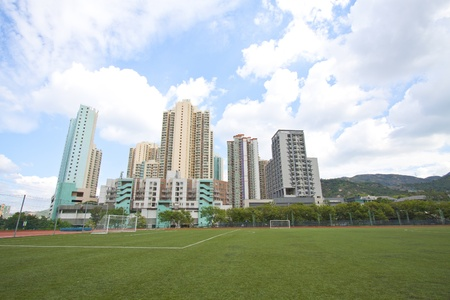 Hong Kong downtown with residential buildings and sports court