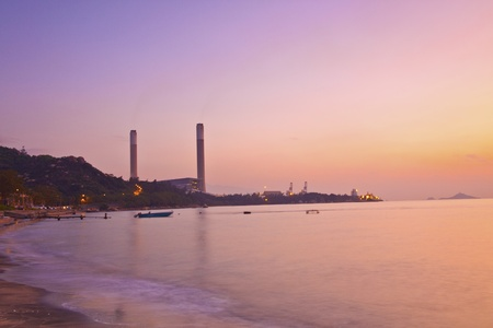 Power plant along the coast at sunset time photo