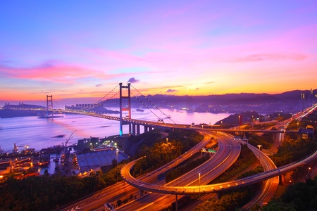 Tsing Ma Bridge at sunset moment in Hong Kong Imagens