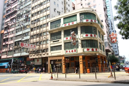 HONG KONG - MAR 12, A busy street with old apartment blocks in Wai Chai, Hong Kong on 21 March, 2011.