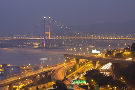 Tsing Ma Bridge and highway at sunset, show the modern landscape of Hong Kong. photo