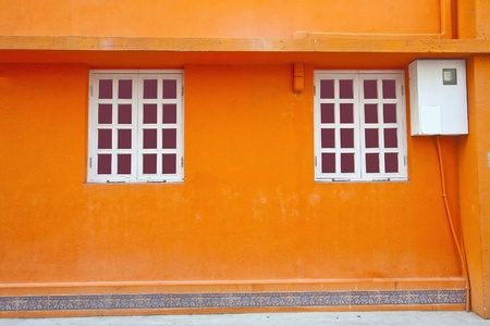 Vintage wall and windows in orange background photo