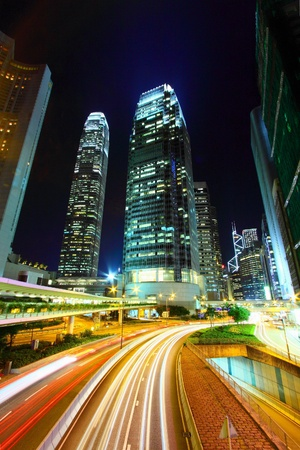 Traffic in city at night, it shows the busy business environment of Hong Kong. photo