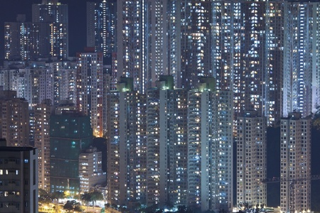 housing development: Hong Kong crowded apartments at night - The feeling of  Stock Photo
