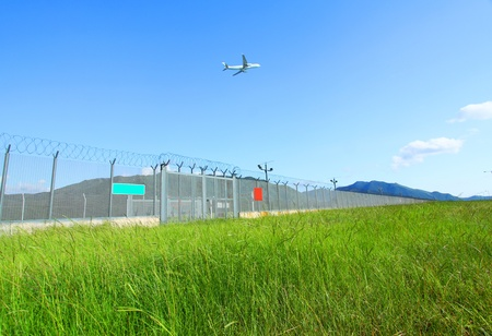 airplane take off: Airplane fly over the green grasses