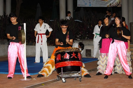 freshmen: HONG KONG - 24 AUG, Lingnan University holds new student orientation every year to welcome freshmen on 24 August, 2011, Hong Kong. Lion Dance society gives a traditional performance.