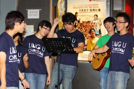 freshmen: HONG KONG - 24 AUG: Lingnan University holds new student orientation every year to welcome freshmen on 24 August, 2011, Hong Kong. Christian Choir is singing to attract students to join their society.