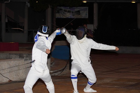 freshmen: HONG KONG - 24 AUG, Lingnan University holds new student orientation every year to welcome freshmen on 24 August, 2011, Hong Kong. Lion Fencing society gives a fencing performance.