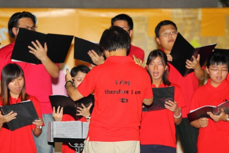 freshmen: HONG KONG - 24 AUG, Lingnan University holds new student orientation every year to welcome freshmen on 24 August, 2011, Hong Kong. Christian Choir gives a singing performance.