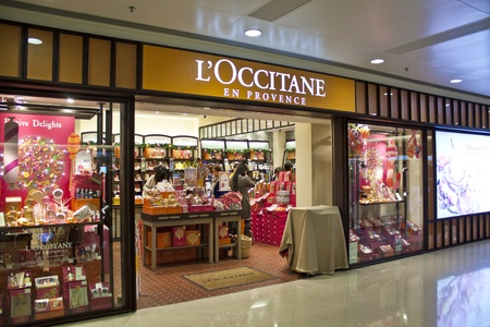 HONG KONG - DEC 22,  LOccitane opens a shop in Tuen Mun, Hong Kong on 22 Decemeber, 2011. There are many people shopping there.