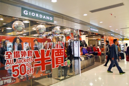 HONG KONG - DEC 22,  Giordano opens a shop in Tuen Mun, Hong Kong on 22 Decemeber, 2011. There are many people shopping there.