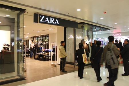 HONG KONG - DEC 22,  Zara opens a shop in Tuen Mun, Hong Kong on 22 Decemeber, 2011. There are many people shopping there.