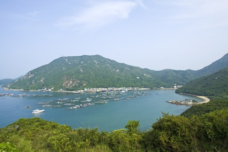 Fishing village from hill top at day  photo