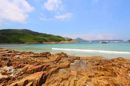 Beach with rocky shore in Hong Kong photo