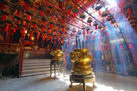 HONG KONG - JULY 26:Man Mo temple in Hong Kong with many incense coils on July 26, 2011. It was graded as a Grade I historic building in 1993 and it is now a declared monument.