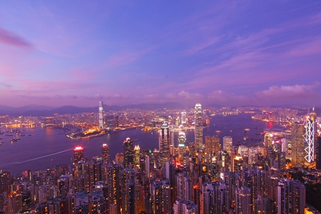 Hong Kong with many office buildings at sunset photo