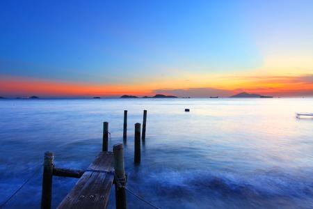 Sunset along a wooden pier in Hong Kong photo