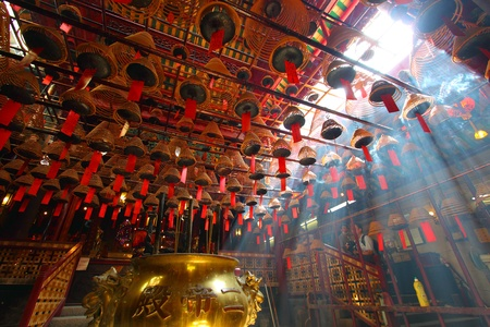 HONG KONG - 26 Jul, Man Mo temple in Hong Kong with many incense coils on 26 July, 2011. It is a very famous temple in Hong Kong for the worship of the civil or literature god Man Tai. It was graded as a Grade I historic building in 1993 and it is now a d Editorial