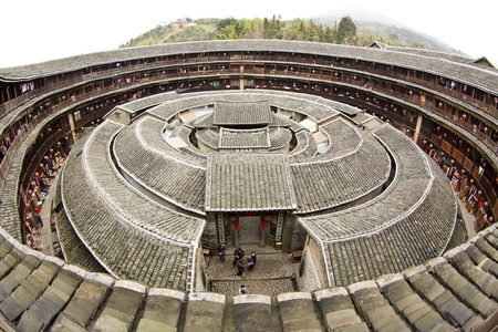 southeastern: Fujian Tulou house in China. It is the Chinese rural dwellings of the Hakka and others in the mountainous areas in southeastern Fujian, China.