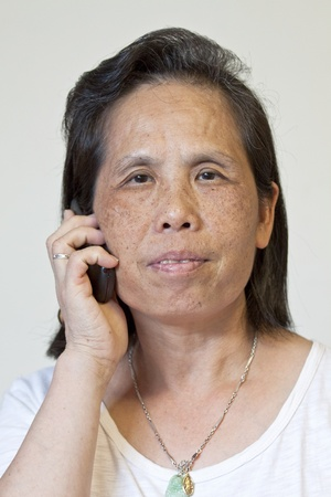 Asian woman talking on phone photo